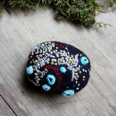 Embroidered felted stone