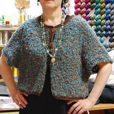 One Skein Cropped Cardigan - This pretty spring cardigan has an over-sized fit and is worked from the top to the bottom and back and forth without seams.