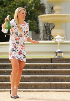 Angelique Kerber of Germany looks on after spraying champagne with the Daphne Akhurst Memorial Cup during a photocall at Government House after winning the 2016 Australian Open on January 31, 2016 in Melbourne, Australia.