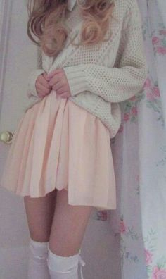 High waisted A line skirt with a baggy sweater. Classic look.