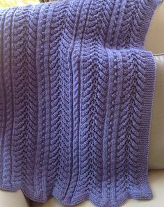 Free Knitting Pattern for 6 Row Repeat Turtle Cove Baby Blanket - Baby blanket knit in a 6 row repeat of alternating ripple, cable, and bobbles sections. The cable and bobble stitch patterns are reverse sides of the same pattern making this blanket reversible. 30 x 34″ Designed by Kelly Klem. Pictured project by stennas who knit on larger needles for a lacier effect.