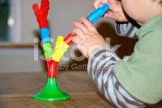 Developing Fine Motor Skills with Toppletree Game royalty-free stock photo Game Calls, Child Love, Fine Motor Skills, Royalty Free Stock Photos, Games, Image, Motor Skills, Fine Motor, Gaming