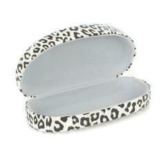 Beautiful hard-shell glasses case in a trendy white snow leopard print design keeps your eyeglasses safe and clean. Covered in faux leather; snap-shut closure.
