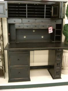 The perfect scrapbooking desk. From hobby lobby. If I ever see it again it is so totally mine