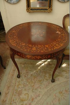 """Stunning round inlay wood table with Chippendale claw feet and measuring 36""""x28"""". Possibly 1940s. Contents of an INCREDIBLE century old estate."""
