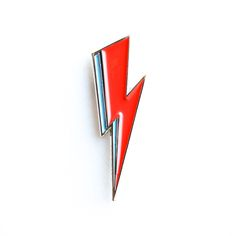 Bowie inspired soft enamel red and blue lightening bolt pin.DETAILS:1 inchdie-strucksoft enamel + high polished nickel**Limited Quantities**