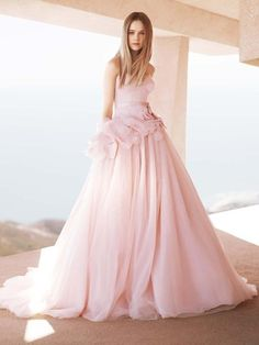 New fashion trend? Colored wedding dresses. This is gorgeous in pink!