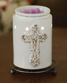 Scentsy Antique Cross warmer. Step into a centuries-old cathedral with this enduring symbol of hope, displayed upon a white crackle finish.  Ask me how to get your Scentsy FREE! Please JOIN any open PARTY before you shop!  Bundle & Save even more under SPECIALS tab!  Shop here: https://keyva.scentsy.us/shop/p/29922/antique-cross-warmer  Thank you for your business!!