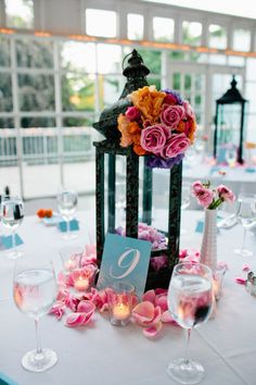 lantern centerpiece with the petals on the table! LOVE the idea