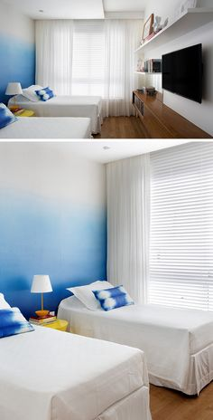 Bedroom Design Ideas - The designers of this apartment used an ombre wallpaper in the bedroom to create an accent wall that's stylish and less overpowering than a full blue wall.