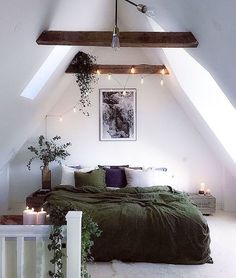 Tucked in the eaves with lovely light, rustic beams and plants