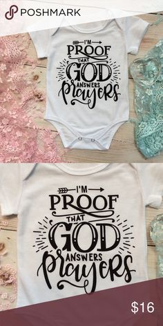 Baby Unisex PROOF GOD ANSWERS PRAYERS Onesie Gender neutral white short sleeve onesie with black IM BROOF THAT GOD ANSWERS PRAYERS design across the front. One Pieces Bodysuits