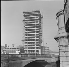 January 1964 A view from across the River Liffey in Dublin of Liberty Hall under construction. Until recently, it was the tallest building in Dublin. Date: Thursday, 23 January 1964 Dublin Street, Dublin City, Old Pictures, Old Photos, Ireland Homes, Dublin Ireland, Beautiful Buildings, Skyscraper, Travel Destinations