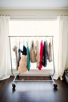 I want a roller closet rack in my room REAL bad.  Style at Home: Monika Of The Doctor's Closet. Photographed by Ellen Ho of Hong Photography