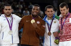 From left, silver medalist Iran's Sadegh Saeed Goudarzi, gold medalist United States' Jordan Ernest Burroughs, bronze medalist Uzbekistan's Sosian Tigiev, and bronze medalist Russia's Denis Tsargush, participate in the medals ceremony for men's 74-kg freestyle wrestling competition at the 2012 Summer Olympics, Friday, Aug. 10, 2012, in London. (AP Photo/Paul Sancya)