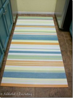 How To Make A Hand Painted Floor Cloth - Addicted 2 Decorating®Addicted 2 Decorating has a great tutorial on making a floor cloth from vinyl flooring remnants. Seal with an exterior grade sealant to create the perfect accent to brighten up that front porch!