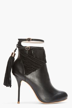 "SOPHIA WEBSTER Black Leather Tasseled Kendall Ankle Boots-Ankle high leather boots in black. Round toe. Rosegold tone hardware. Thin strap and double pin buckle closure at ankle. Suede fringe detail at ankle. Zip closure at heel with tasseled suede zipper pull. Tonal heel. Tonal stitching. Approx 4"" heel. Leather upper, leather sole. Imported. Price: $795 USD SEE DETAILS HERE: http://www.designerhandbagspurses.net/sophia-webster-shoes/"