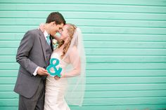 """Couple Holding """"&"""" Sign Green Backdrop"""