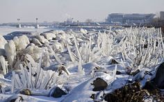 Ice covers rocks and brush on the break wall at Edgewater Park in Cleveland.January 2014
