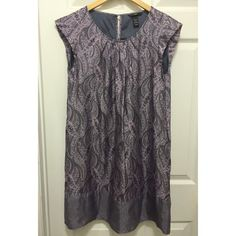 SALENever Worn H&M Lavender Paisley ShiftDress Beautiful satiny lavender paisley print shift dress from H&M. Never worn. Gathering at neckline. Cap sleeves. Has a bit of sheen. Two different paisley prints. Bottom print has a lavender/ grayish quality. Has lining. Pockets at sides. Button opening on back. Shell: 100% viscose. Lining: 100% acetate. Size 8. H&M Dresses