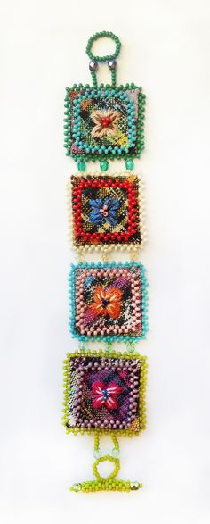 Dunitz & Company | Booth 557 | February 2014 http://www.dunitz.com/ http://www.sfigf.com/ Hand beaded & embroidered on traditional Guatemalan fabric bracelet. Colors & embroideries will vary making each piece totally unique. Presented by Fair Trade Federation member company.