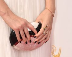 Pin for Later: These Gorgeous Award Show Manicures Hit a High Note Kate Mara At the 2014 Emmy Awards, Kate chose a dark manicure that contrasted beautifully with her pale gown.