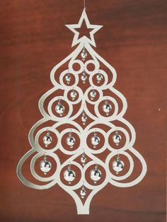 Christmas decorations made of paper, cardboard, foil, sequins, beads