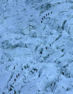 FILE - In this Sunday, May 18, 2003 file photo, mountaineers pass through the treacherous Khumbu Icefall on their way to Mount Everest near Everest Base camp, Nepal. (AP Photo/Gurinder Osan, file) ▼18Apr2014AP|Avalanche sweeps down Everest, killing at least 12 http://bigstory.ap.org/article/avalanche-sweeps-everest-6-killed-9-missing #Khumbu #Everest #Everest_Base_camp