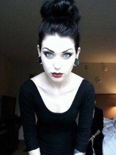 Dramatic eye makeup: check Eyebrows: check Messy bun: check