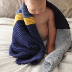 Soft and cuddly knit baby blanket inspired by the free purlbee colorblock bias blanket pattern.