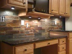 Kitchen Backsplash Rock backsplash! love the color and mood this gives! | kitchen &bath