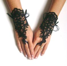 Black fingerless gloves - french lace. Imagine these with a black lacey silk corset, stockings and heels.  Oh my..