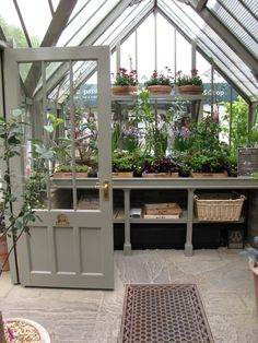 greenhouse One day maybe I will have my own green house! INDOOR GARDEN :: Love love love this greenhouse! GOOD IDEA: Keep plants together on wooden trays labeled with the types of plants. Backyard Greenhouse, Greenhouse Plans, Greenhouse Wedding, Greenhouse Benches, Potting Benches, Small Greenhouse, Balcony Garden, Greenhouse Attached To House, Greenhouse Staging