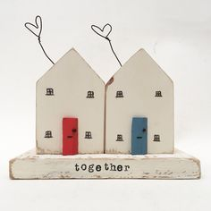 A personal favourite from my Etsy shop https://www.etsy.com/uk/listing/509466307/together-a-pair-of-little-wooden-houses