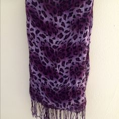 Purple Leopard-Print Scarf This is a lightweight scarf with different shades of purple throughout the print. From Target, but I can't remember the specific brand. Target Accessories Scarves & Wraps