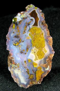 Tapado plume. This agate is about two inches long, with a multi-colored plume that appears to run the length of the agate.