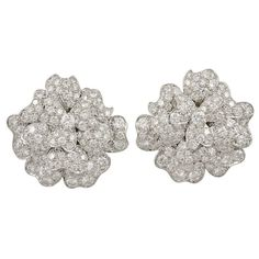 VAN CLEEF & ARPELS Diamond Flower Earrings | From a unique collection of vintage clip-on earrings at http://www.1stdibs.com/jewelry/earrings/clip-on-earrings/