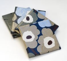 Marimekko coasters, Unikko in Dark Blue, Olive Green, Sky Blue and Beige, set of 4.  via Etsy. Finland