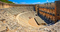 The Roman Theatre of Aspendos, Turkey.  Built in 155 AD during the rule of Marcus Aurelius, Aspendos Theatre is the best preserved ancient theatre in Asia Minor. 96 metres in diameter it can seat 7000 the csaenae frond or backdrop wall is still intact. Following Hellenistic traditions the theatre is built into the hillside below the Acropolis.