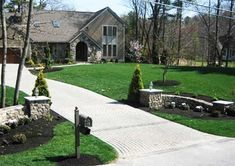 wonder if a snow plow would wreck this? concrete driveways with stone gate posts