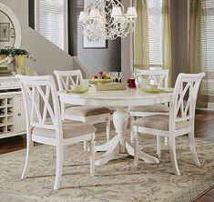 White round table (that can extend)...pair with different chairs though.