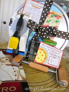 Mama Mia! Pizza Gift Set: Pizza Pan or Stone, Pizza Cutter, Rolling Pin, Dish Towels, Pizza Sauce, Seasonings. Basting Brush. Cutting Board/ Rolling Mat, Cookbook
