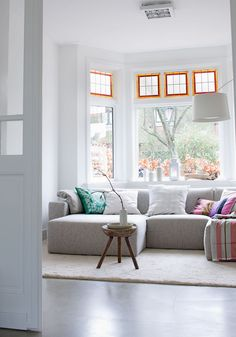 Bright, sofa in front of window