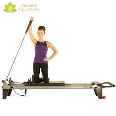 overhead press pilates reformer exercise 2