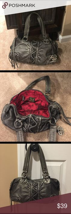 🌺🌺 RED by MARC ECKO 🌺🌺 Stunning Handbag 🌺🌺 RED by MARC ECKO 🌺🌺 Stunning Handbag 👜 preloved in excellent condition.  Beautiful gun metal color with a gorgeous red inside!  Measurements are 14 length 7 height & 5 width Red by Marc Ecko Bags Satchels