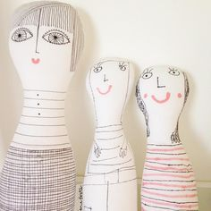 Hand illustrated dolls that I made with my daughter - I gave her a flat piece of cotton to draw onto and then I did the sewing and she did the stuffing!
