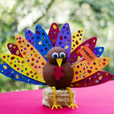This is a cute turkey project using  3-inch and a 6-inch craft foam balls that are cut in half and painted brown.  Use yellow, orange, and brown tail feathers and glue sequins on them.  Add wiggly eyes, pipe cleaners for the legs, and orange construction paper for the beak.  These turkeys have a flat back, so they could also be added to a Thanksgiving bulletin board display to give it a fun 3 dimensional effect.