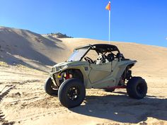 Desert Tan Polaris RZR XP 1000 2-seat with a Vent Racing Coupe Cage.