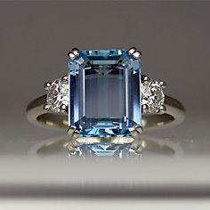 A beautiful aquamarine paired with diamonds - simple but elegant.