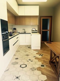 I like the interwoven tile and wood, but also how the tile is basic so doesn't fight with the tile but with random interesting design tiles also inlcluded Kitchen Interior, New Kitchen, Kitchen Decor, Kitchen Design, Floor Design, House Design, Cuisines Design, Kitchen Flooring, Home Kitchens